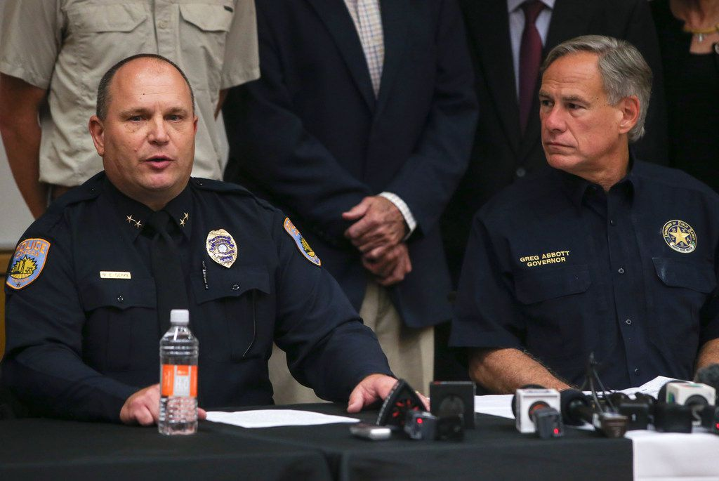 Odessa Police Chief Michael Gerke, left, speaks alongside Texas Governor Greg Abbott during a press conference at the University of Texas Permian Basin on Sunday, Sept. 1, 2019 in Odessa, Texas. At least seven people died after more than 20 people were shot Saturday when a gunman hijacked a postal truck and began shooting randomly in the Odessa area of West Texas, authorities say.