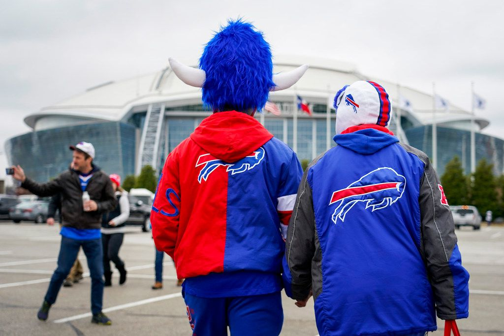 Buffalo Bills fan Sam Huerta and Diana Medina head to the stadium before an NFL football game between the Dallas Cowboys and the Buffalo Bills at AT&T Stadium on Thursday, Nov. 28, 2019, in Arlington. (Smiley N. Pool/The Dallas Morning News)