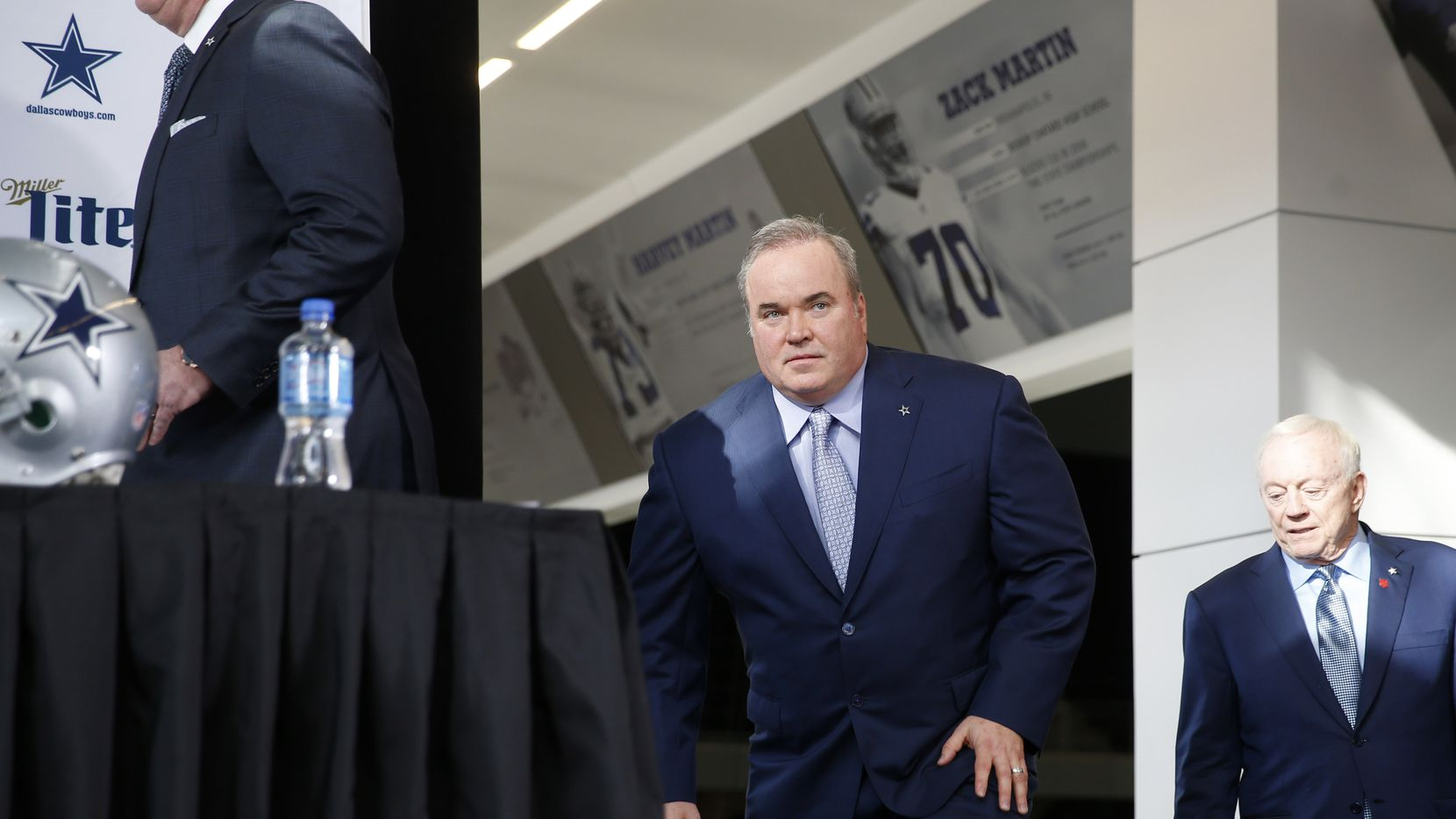 FILE - Cowboys head coach Mike McCarthy makes his way to the stage before a press conference in the Ford Center at The Star in Frisco on Wednesday, Jan. 8, 2020.