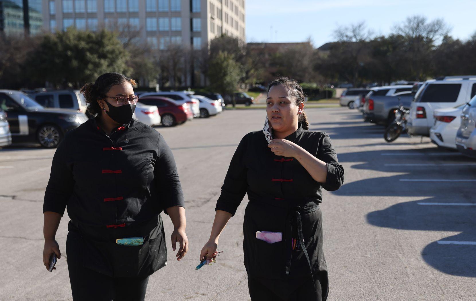 Jonnay Mckinley and her sister, Kelechi Young (left) head to work at P.F. Chang's on Monday, February 1, 2021.