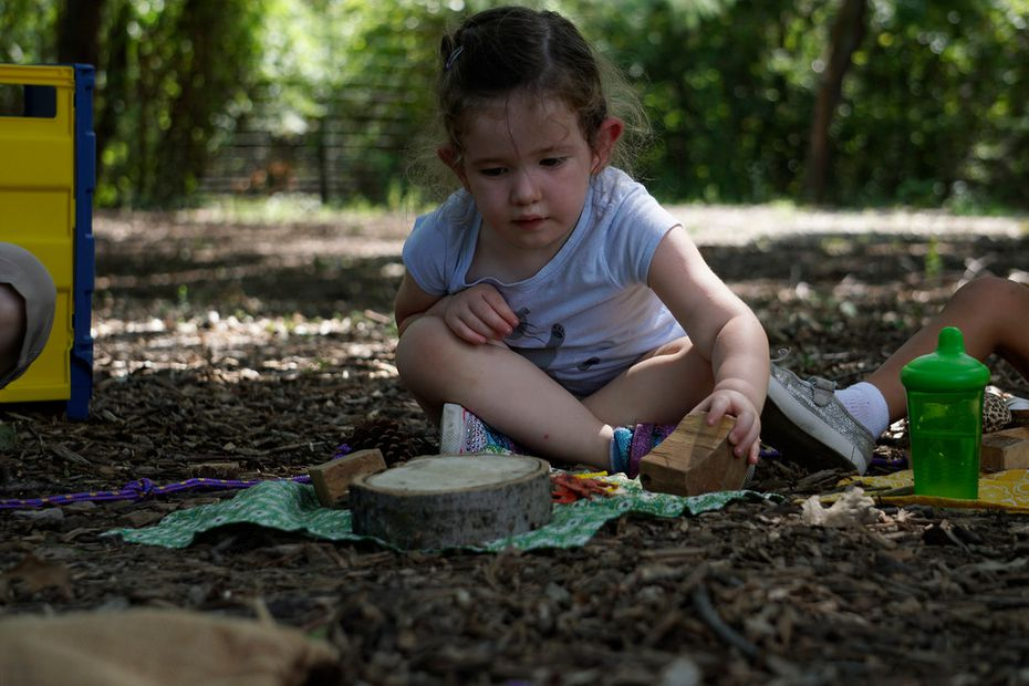 Emery Baumhardt, 3, plays outside at the Dallas Zoo's Wild Earth Preschool on Thursday.