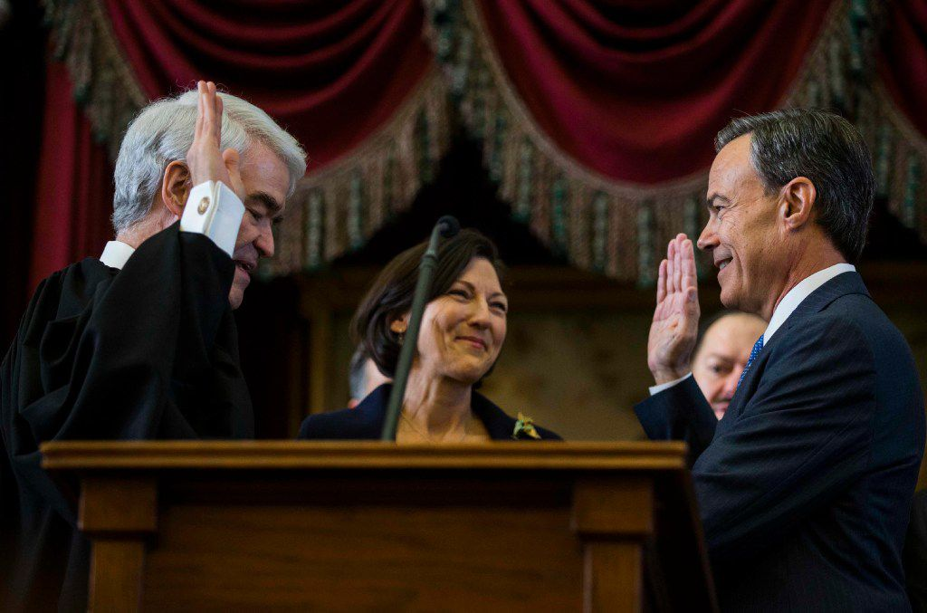 Texas State Representative Joe Straus, right, is sworn in as Speaker of the House by Texas Chief Justice Nathan Hecht, left, during the first day of the 85th Texas Legislative Session on Tuesday, January 10, 2017 at the Texas State Capital in Austin, Texas. Straus' wife, Julie Brink, is center. (Ashley Landis/The Dallas Morning News)