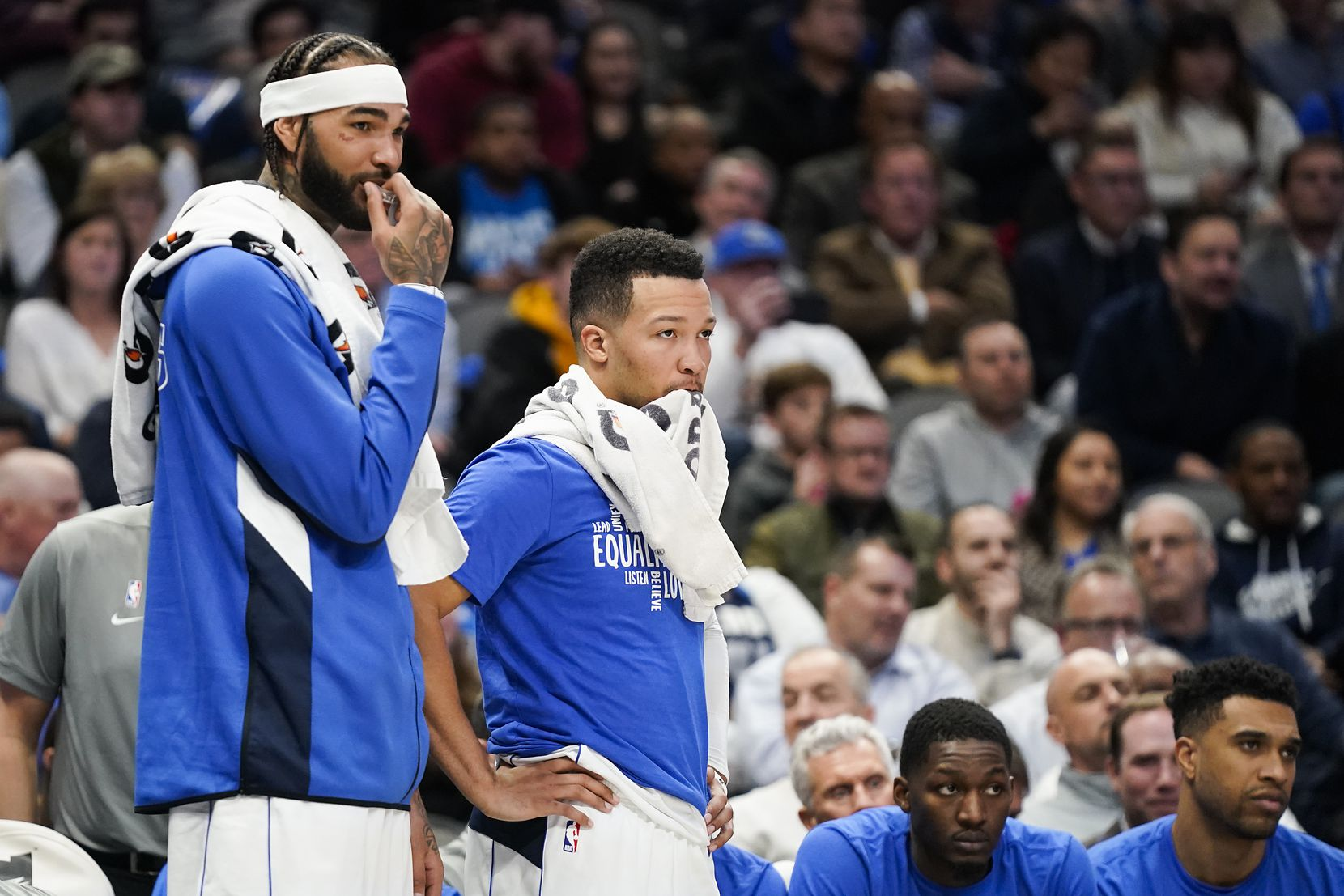 Dallas Mavericks center Willie Cauley-Stein (left) and guard Jalen Brunson watch from the bench during the second half of an NBA basketball game against the Memphis Grizzlies at American Airlines Center on Wednesday, Feb. 5, 2020, in Dallas.