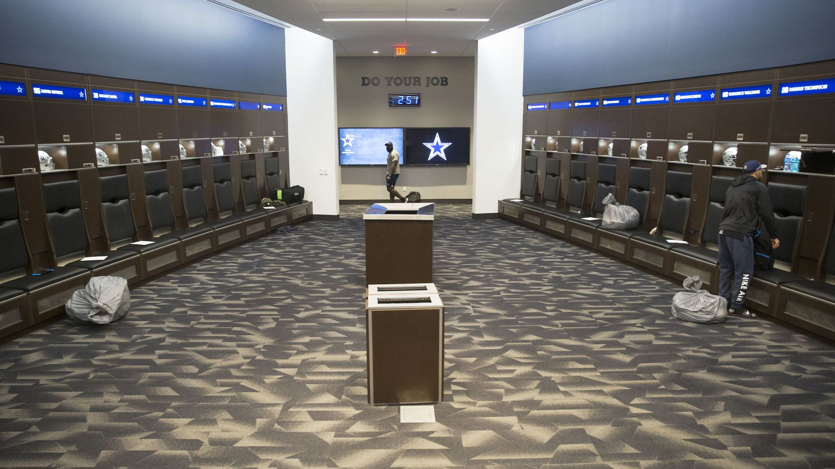 Dallas Cowboys safety Darian Thompson, right, at his locker at Ford Center at the Star in Frisco, Texas on Sunday, January 13, 2019. The Cowboys lost to the Los Angeles Rams on January 12, ending their season.