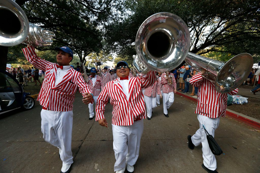 SMU band members Edwin Mendoza (left), Juan Rios (center) and Philip Sommers perform on the campus before the SMU and UCF football game on Saturday, Nov. 4, 2017, in Dallas, Texas. (Jae S. Lee/The Dallas Morning News)