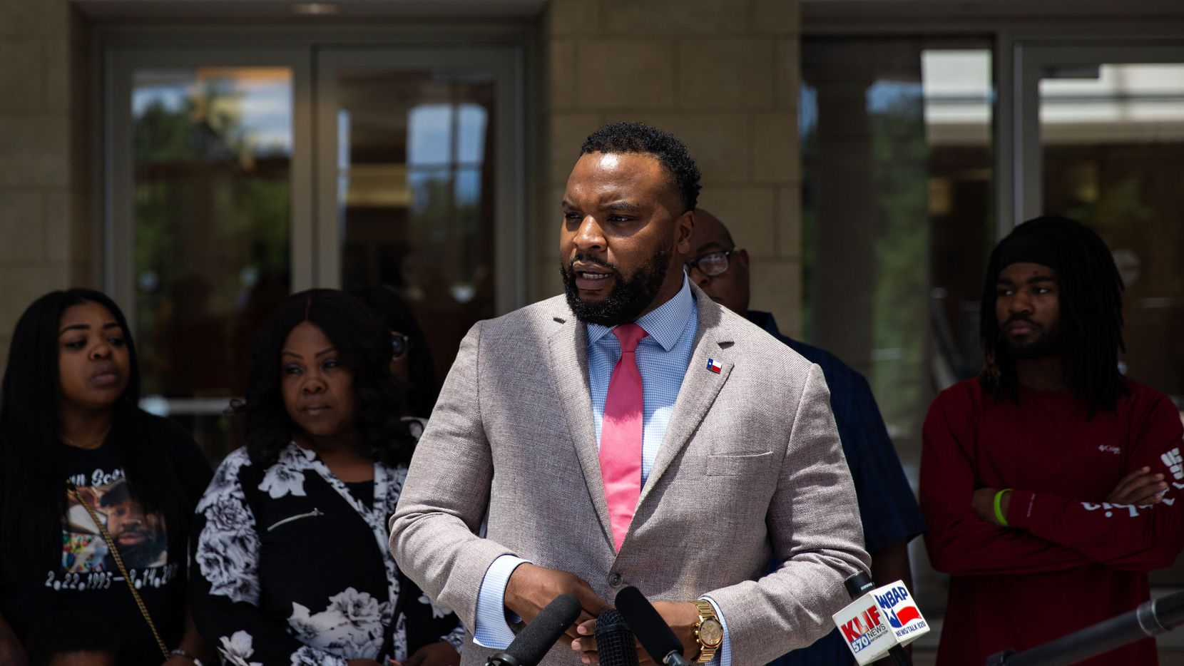 """Attorney Lee Merritt speaks at a press conference at the Collin County Courthouse on July 12, 2021, three days after the release of a 41 minute video leading up to Marvin Scott III's death at the Collin County Jail. """"There were thousands of opportunities to save Marvin's life here,"""" Lee Merritt said at the press conference. """"Marvin Scott was punished for being in a mental health crisis.""""(Shelby Tauber/Special Contributor)"""
