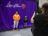 "Antonio (left), 11, poses with brother Lionel, 6, as mom Berdha Reyna takes a photo of them during the Selena 50th birthday celebration at Jaxon Beer Garden on Friday, April 16, 2021. Reyna said that her kids always sing Selena's songs when they pass the mural on West Jefferson Blvd. ""Su musica es una herencia, Reyna said. Meaning, Selena's music is like an inheritance."