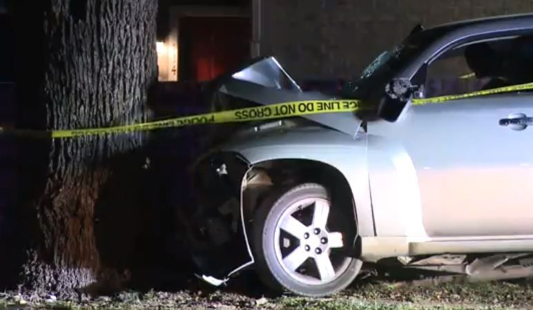 A Chevrolet station wagon is blocked off with crime tape after a man with a gunshot wound crashed it into a tree Tuesday morning, Fort Worth police said.