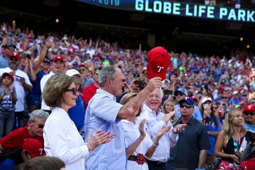 Former President George W. Bush and former first lady Laura Bush are recognized in the 5th inning during a MLB game between Texas Rangers and New York Yankees on Sunday, September 29, 2019 at Globe Life Park in Arlington, Texas.