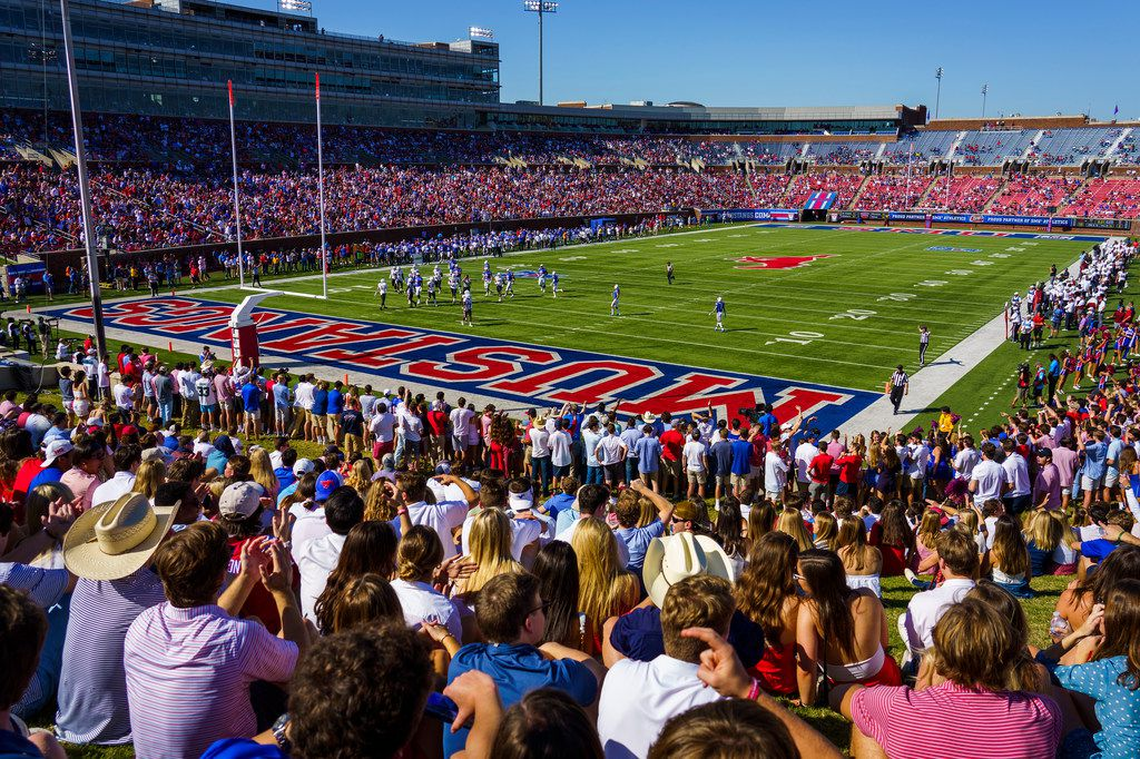 Fans watch during the first half of an NCAA football game between SMU and Temple at Ford Stadium on Saturday, Oct. 19, 2019, in Dallas. (Smiley N. Pool/The Dallas Morning News)