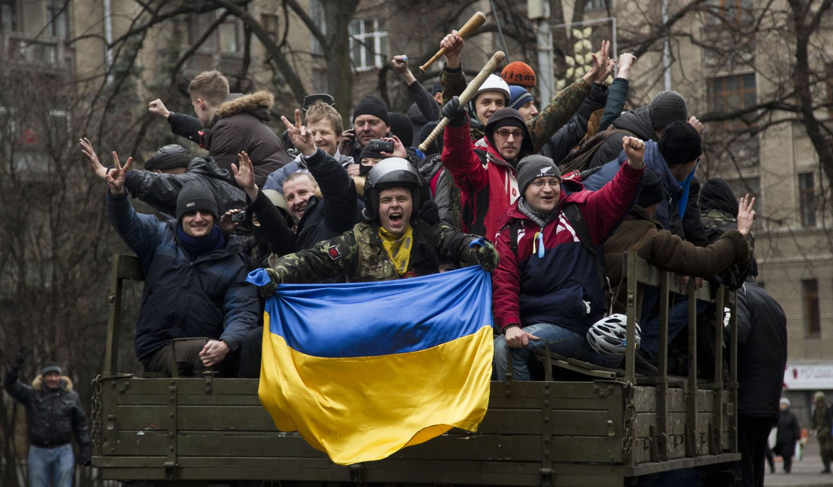 Protesters celebrated the dismissal of President Viktor Yanukovych as they rode through Kiev on Saturday. Yanukovych appeared on television in a pre-recorded interview and declared that he was still the nation's legitimate leader.