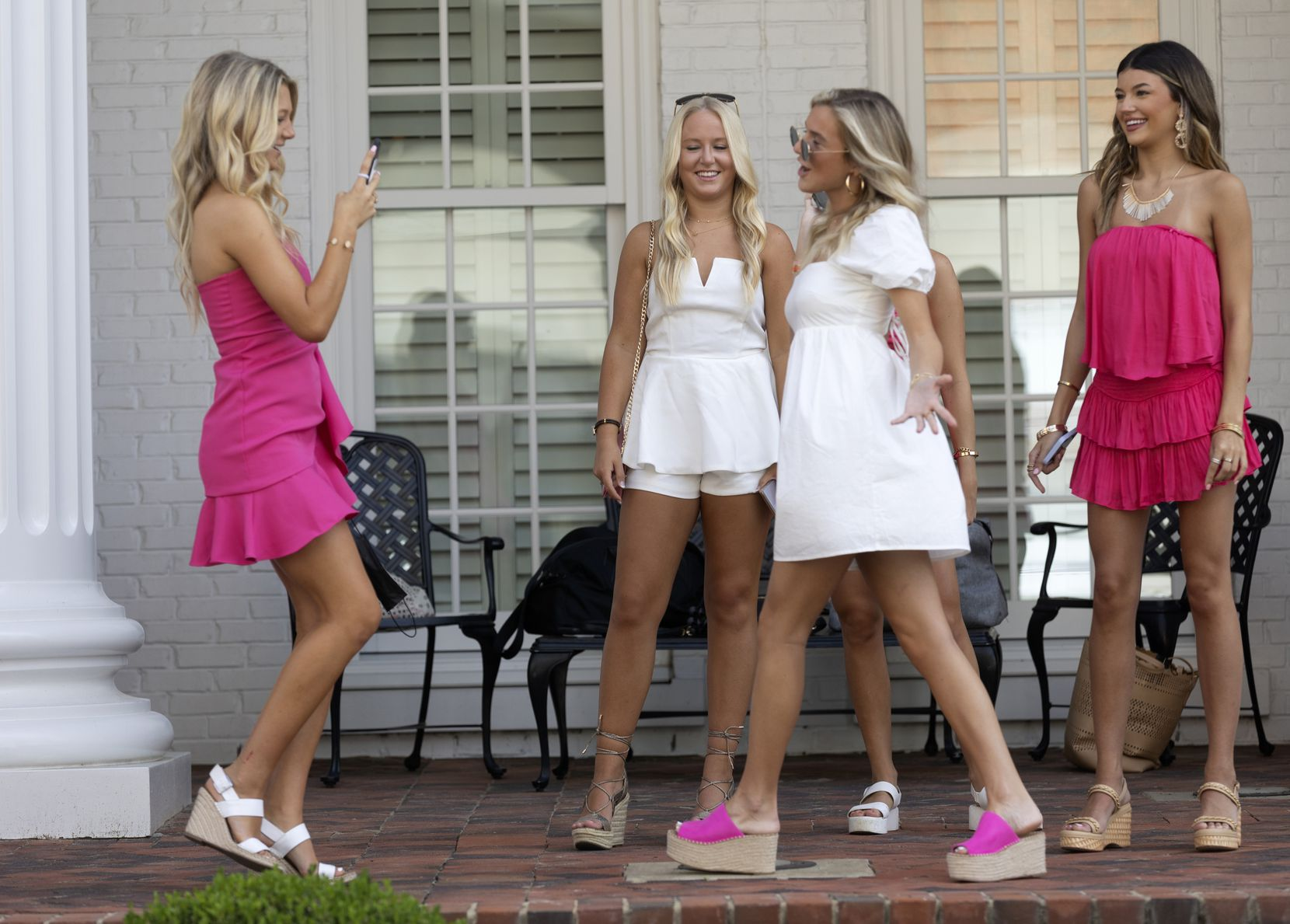 A group of Phi Mu sorority sisters take photos on the morning of bid day on the front steps of their sorority house during University of Alabama's rush week on Aug. 15  in Tuscaloosa, Ala.