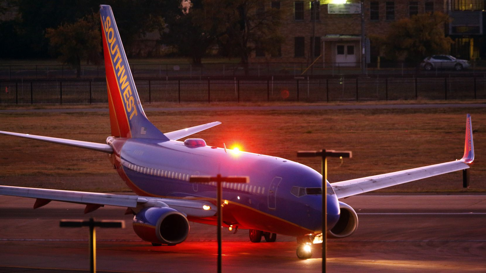 A Southwest Airlines jet taxis to the terminal at Dallas Love Field in October.