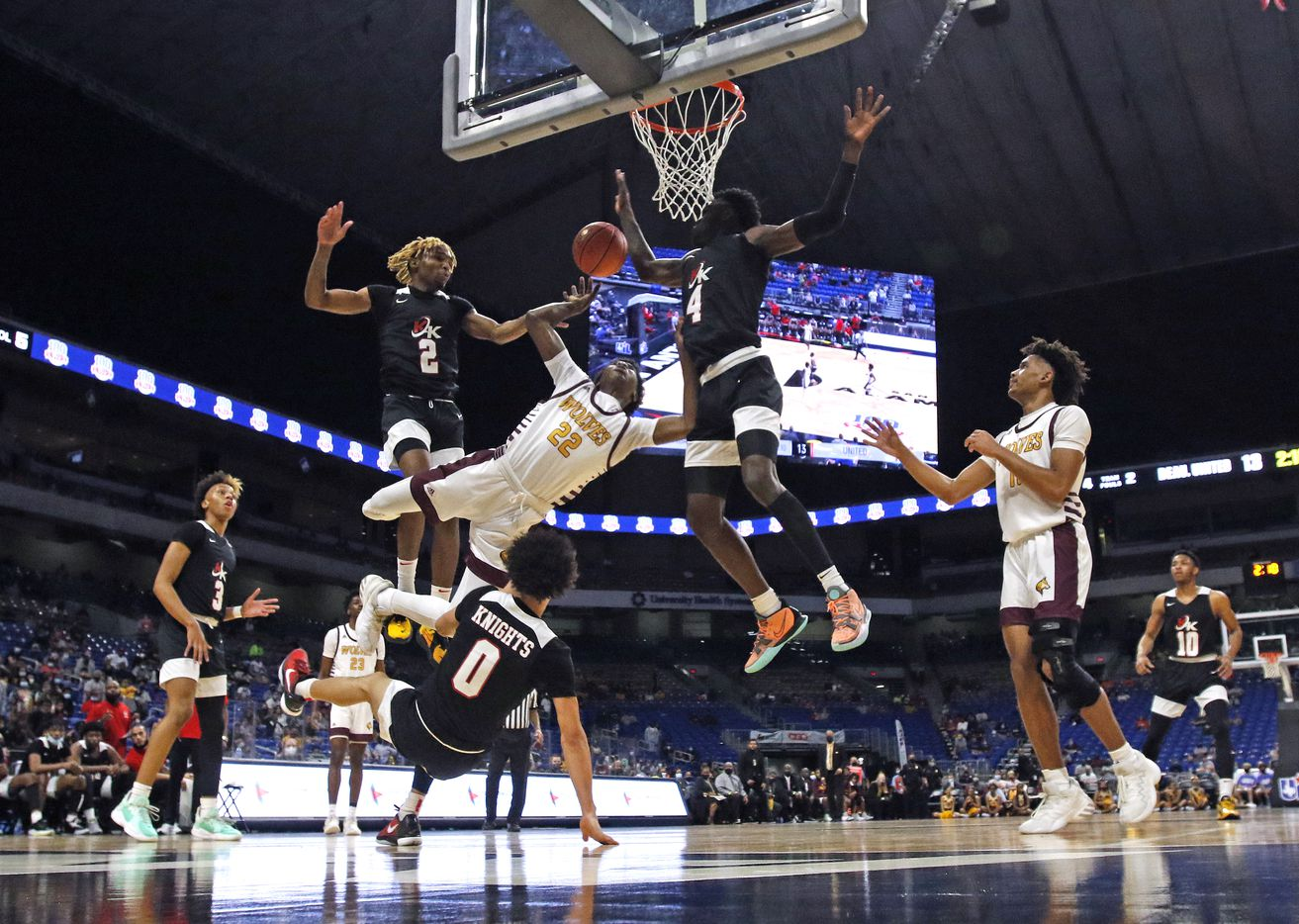 Dallas Kimball Arterio Morris #2 and Dallas Kimball Kyron Henderson #4 combine to stop Beaumont United Clarence Paiya #22. UIL boys Class 5A basketball state championship game on Friday, March 12, 2021 at the Alamodome.