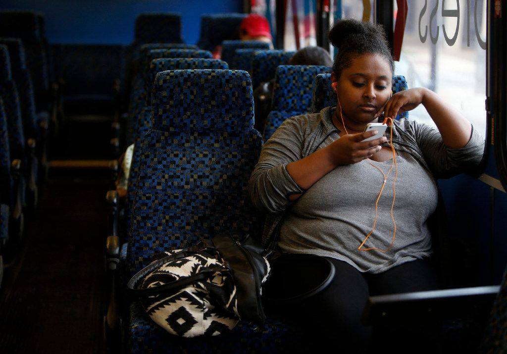 Saliana Girmai waits aboard the Metro ArlingtonXpress bus at College Park Center in Arlington on Nov. 22.
