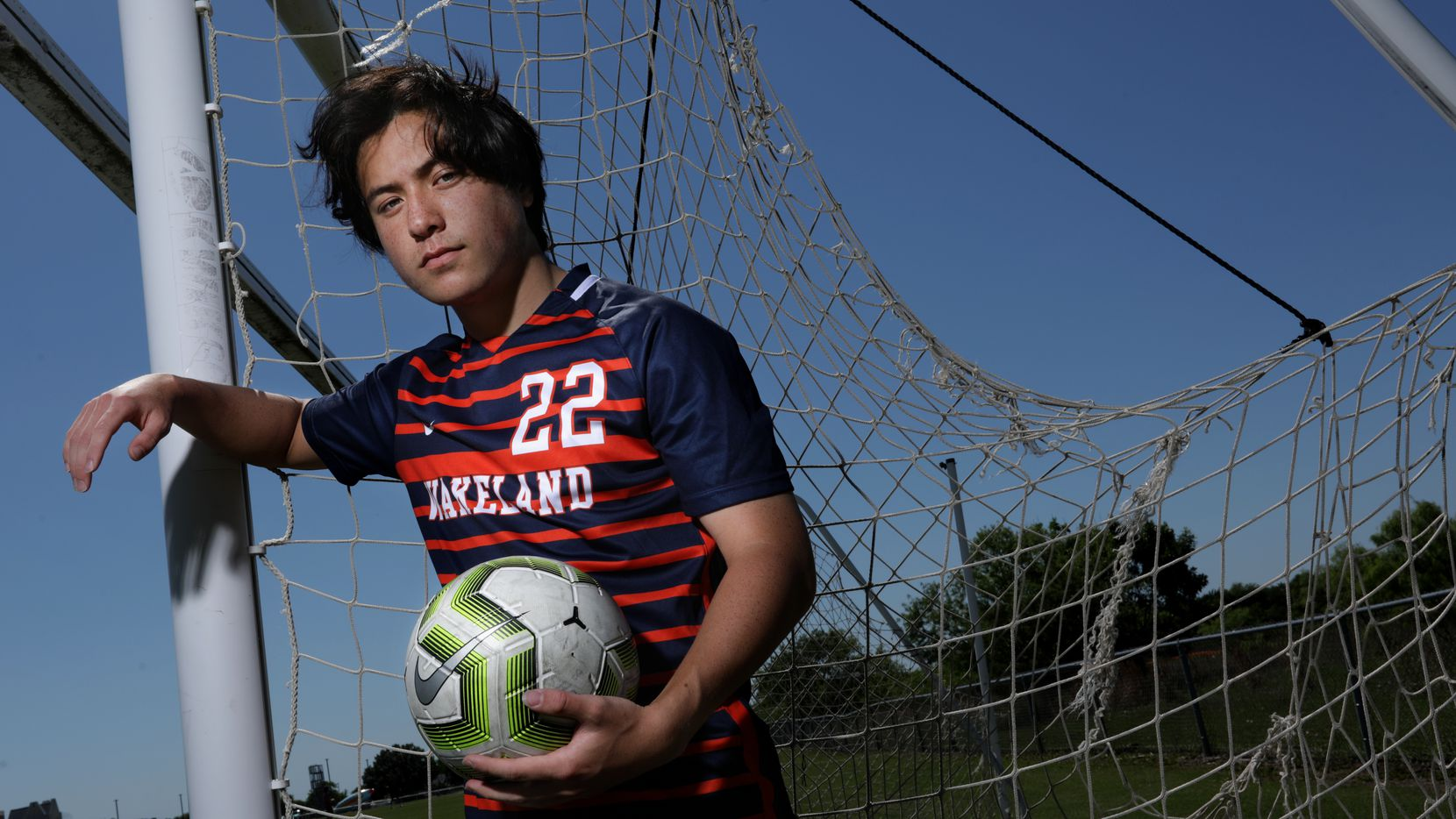 Brennan Bezdek poses for a photograph at Frisco Wakeland High School in Frisco, TX, on May 6, 2021.
