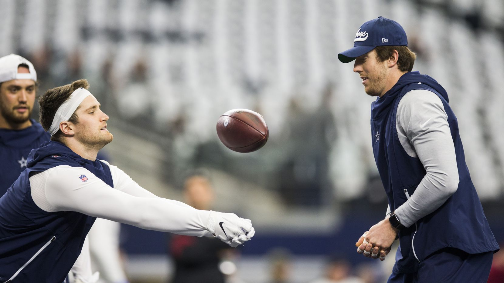 Dallas Cowboys tight end Dalton Schultz (86) and tight end Blake Jarwin (89) play volleyball with a football as they warm up before an NFL game between the Dallas Cowboys and the Washington Redskins on Sunday, December 29, 2019 at AT&T Stadium in Arlington, Texas.