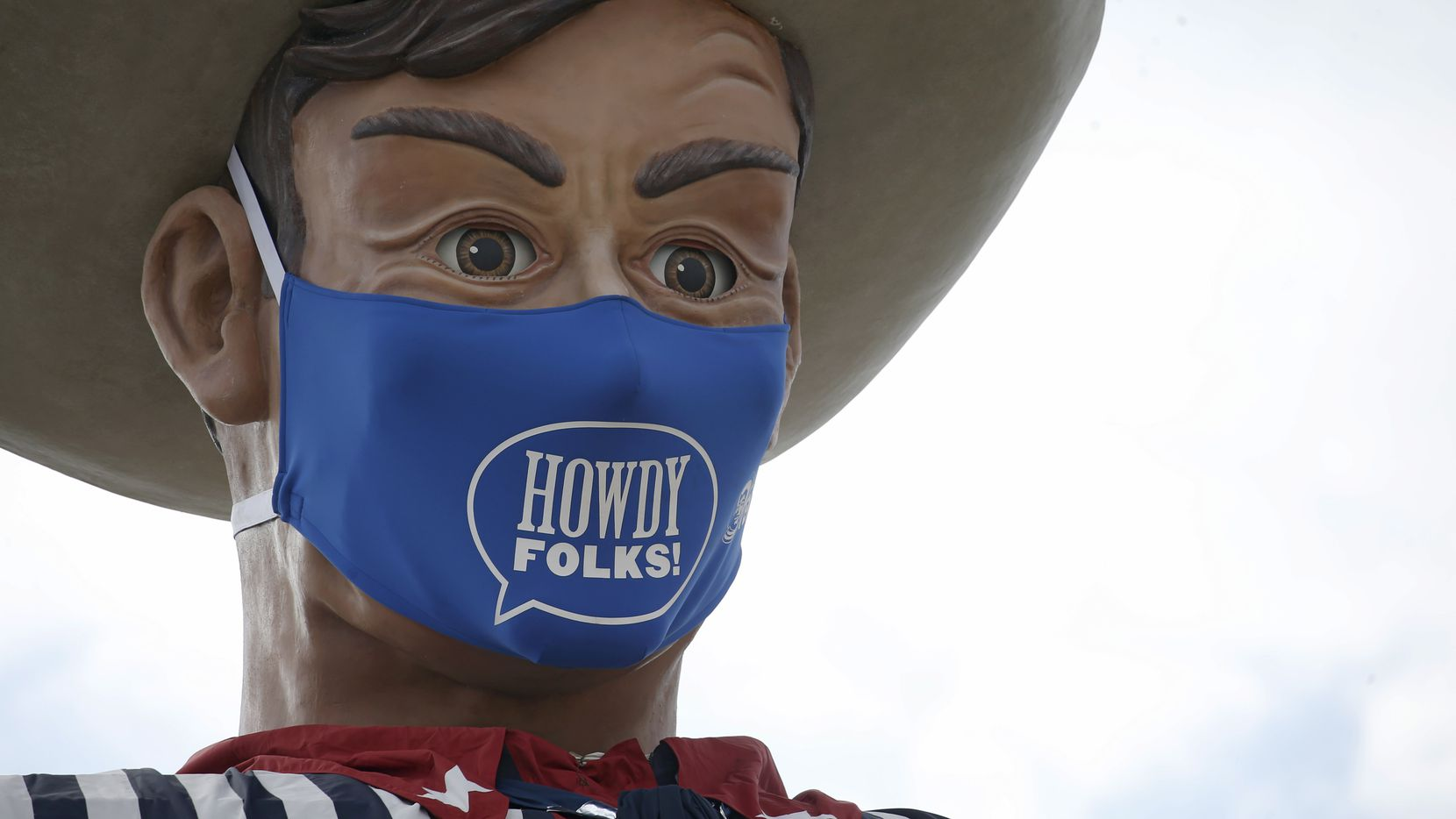 """Big Tex sports a """"Howdy, folks!"""" face mask at Fair Park in Dallas on Wednesday, Sept. 16, 2020. The mask is 84 inches by 45 inches, or roughly 7 feet by 4 feet. The State Fair of Texas has been cancelled this year due to the global pandemic."""