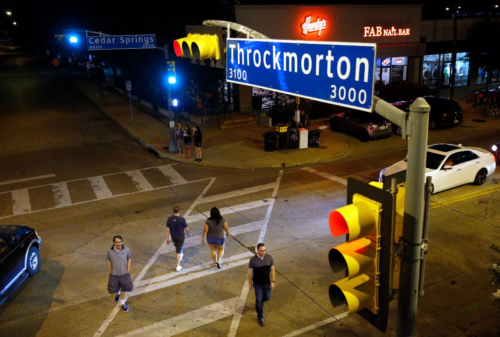 People cross the busy intersection of Throckmorton St. and Cedar Springs Rd. in Dallas, Wednesday, August 23, 2017. (Tom Fox/The Dallas Morning News)