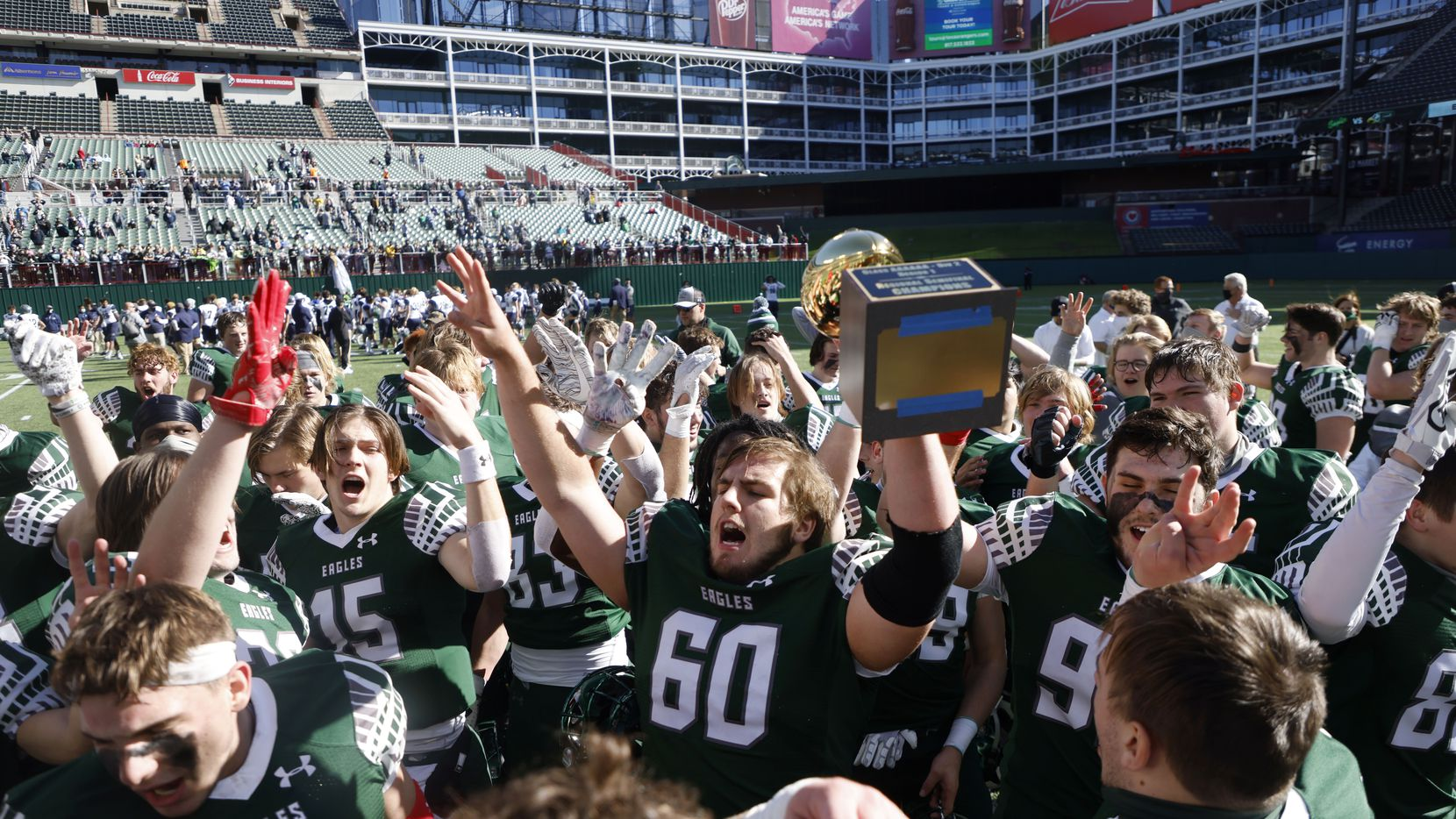Prosper's Nash Gagliano (60) holds the semifinal trophy after they defeated Northwest Eaton 27-17 during the Class 6A Division II Region I semifinal high school football playoff game on Dec. 26, 2020.