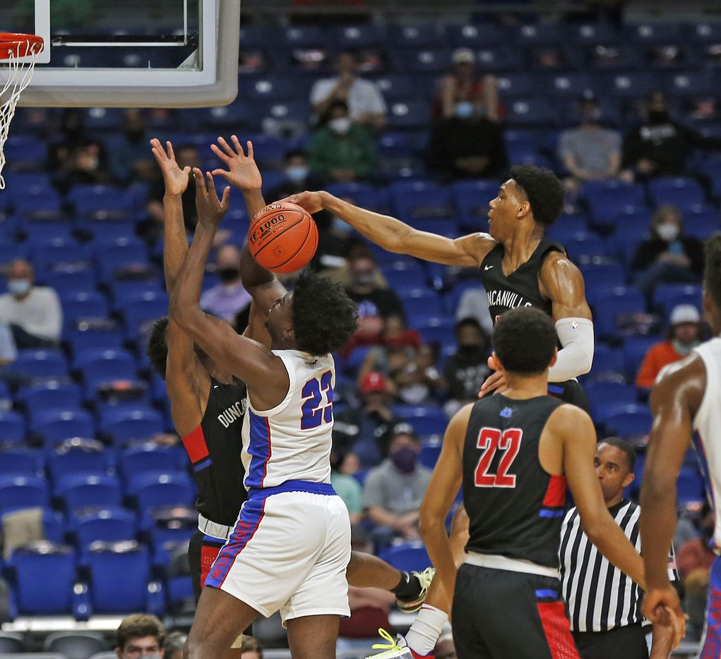 Duncanville Zhuric Phelps #0 blocks shot of Westlake Nehikhare Igiehon #23. UIL boys Class 6A basketball state championship game between Duncanville and Austin Westlake on Saturday, March 13, 2021 at the Alamodome.