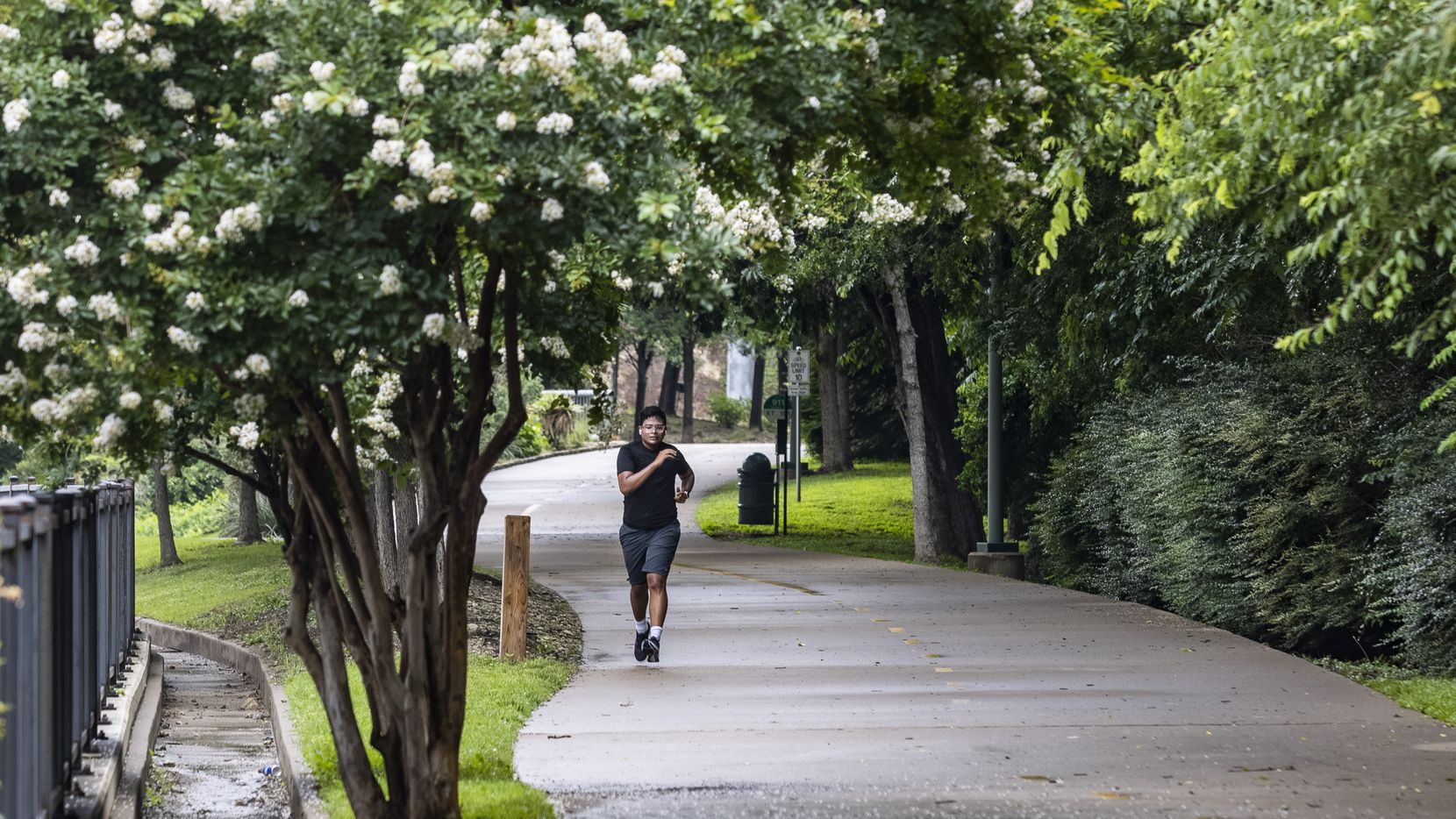 A man runs on the Katy Trail during a misty afternoon in Dallas on Friday, June 4, 2021. Mesquite is seeking resident input on its own parks and recreation facilities.