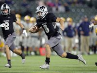 Arlington Martin quarterback Zach Mundell (6) races for the end zone to score the winning touchdown in overtime against Arlington Lamar at Globe Life Park in Arlington on Friday. Martin won 38-31. (Tom Fox/The Dallas Morning News)
