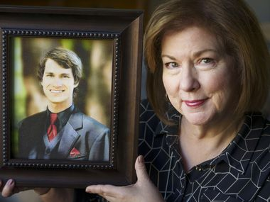 Vanita Halliburton holds a photograph of her son, Grant, at the offices of the Grant Halliburton Foundation on Thursday in Dallas. She co-founded the foundation after her son died by suicide in 2005 at the age of 19.