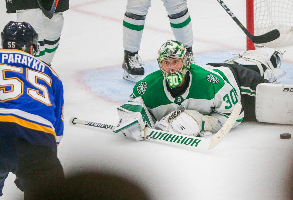 Dallas Stars goaltender Ben Bishop (30) looks at St. Louis Blues defenseman Colton Parayko (55) after he took a shot in the third period of game 5 in an NHL second round playoff series at Enterprise Center in St. Louis, Missouri on Friday, May 3, 2019.(Shaban Athuman/Staff Photographer)