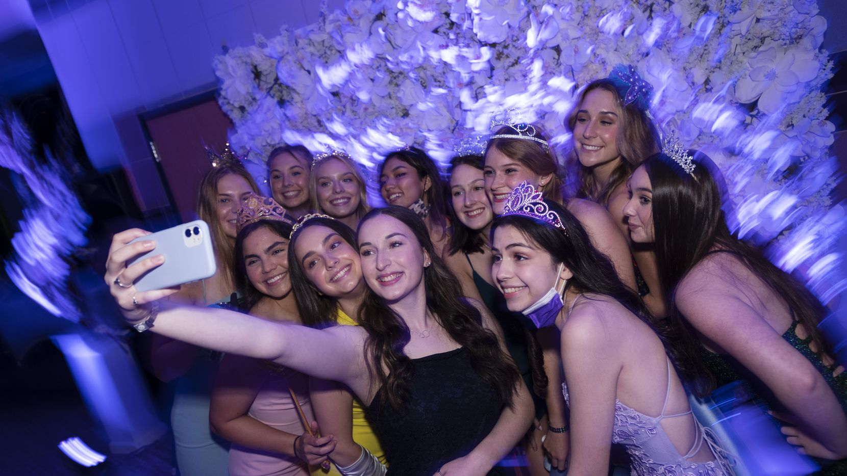 """Richardson High School senior Gracie Oliver, 18, center, takes a selfie with friends during the """"Walk Down Memory Lane"""" even the school hosted for its graduates. The event showcased a slideshow of the seniors, a red carpet experience and plenty of photo opportunities. Oliver entered her senior year not fully knowing what to expect and wondering whether her class would get to have a """"traditional"""" graduation."""
