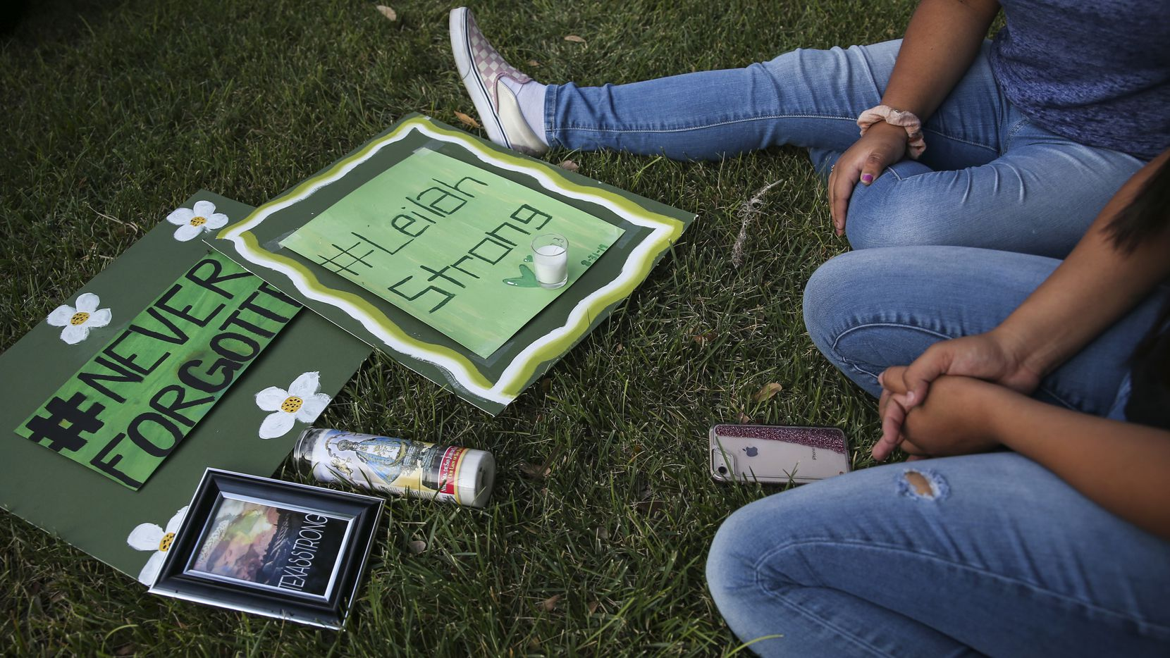 Sajeili Carrasco, 15, bottom right, and Celia Lopez, 15, who were friends with Leilah Hernandez, a 15-year-old Odessa High sophomore who was killed in the attack, gather for a prayer vigil at the University of Texas Permian Basin on Sunday, Sept. 1, 2019.
