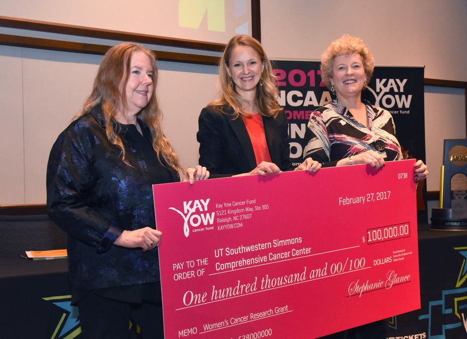 The check of $100,000 was presented to Angelique Whitehurst Monday at UT Southwestern Medical Center.