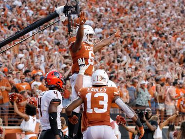 AUSTIN, TX - SEPTEMBER 21:  Devin Duvernay #6 of the Texas Longhorns celebrates with teammates after a touchdown reception in the second quarter against the Oklahoma State Cowboys at Darrell K Royal-Texas Memorial Stadium on September 21, 2019 in Austin, Texas.