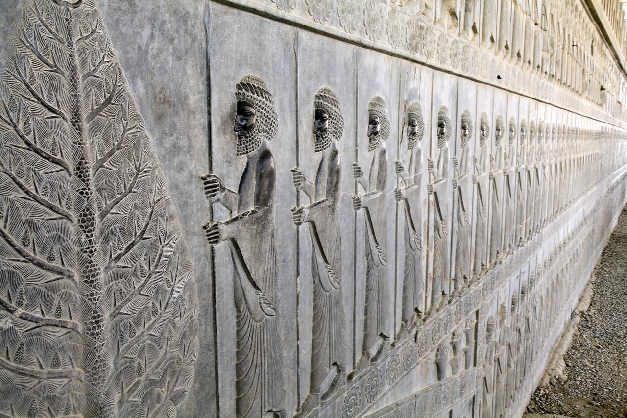 At the ruins of Persepolis,  the 10,000 protectors of the royal family — the Immortal Guards — are memorialized in stone. Many elaborate friezes remain in the ancient capital of the Achaemenid empire.
