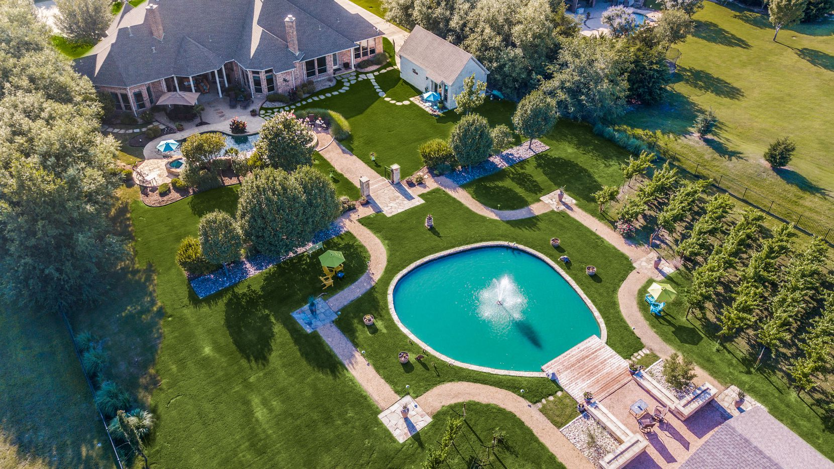 The $1.7 million estate has a private vineyard out back.