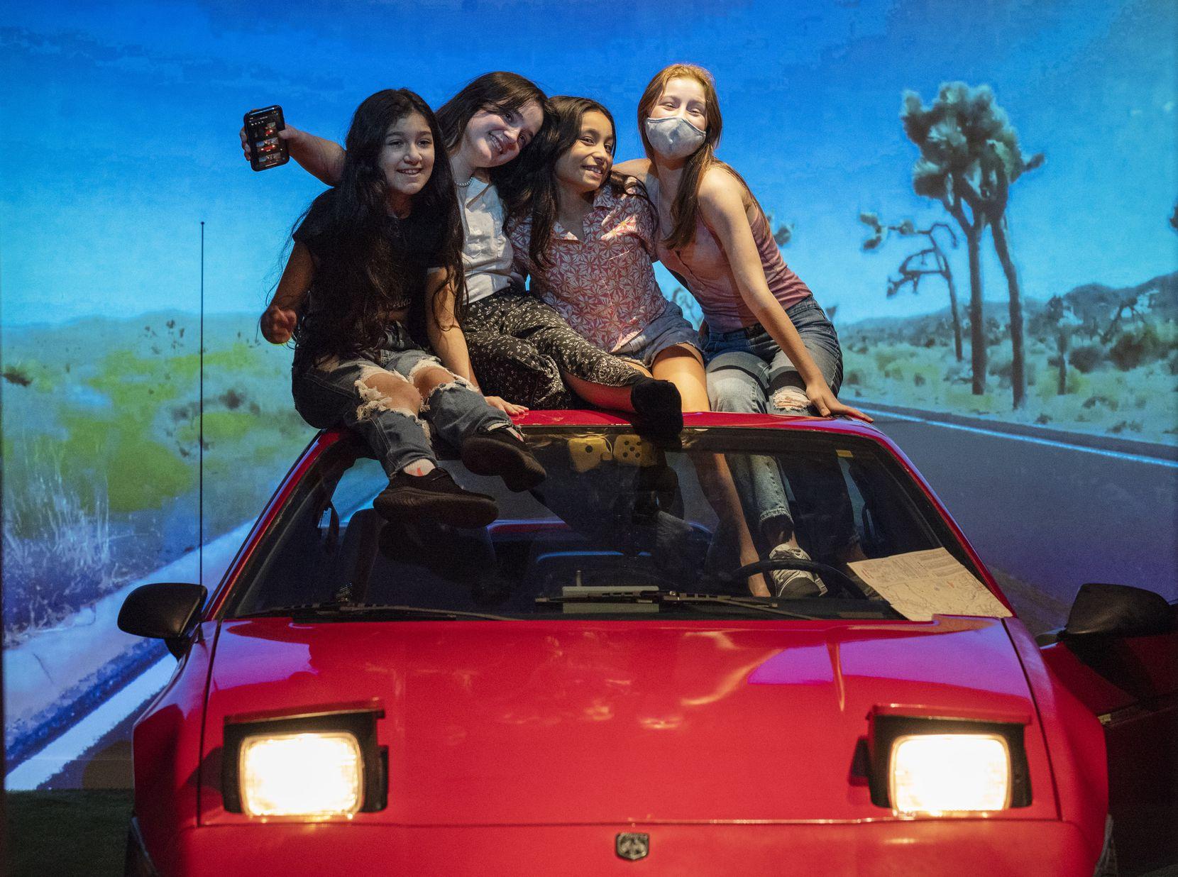 A Pontiac Fiero gets Amalia Diaz (from left), Elenor Small, Elliott Geslani and Penelope Meier revved up.