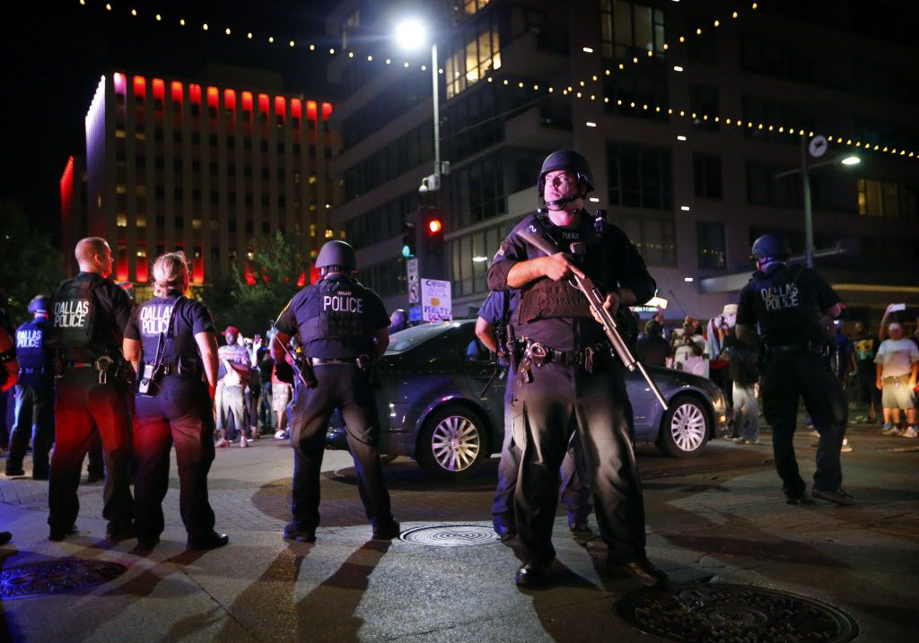 Dallas police in riot gear moved in after protestors took a knee in the intersection of Main St. and S. St. Paul like San Francisco quarterback Colin Kaepernick during the Next Generation Action Network protest in downtown Dallas, Thursday, September 22, 2016. In response to the police killings, the group is standing in solidarity with the families and all of those who want justice for all. (Tom Fox/The Dallas Morning News)