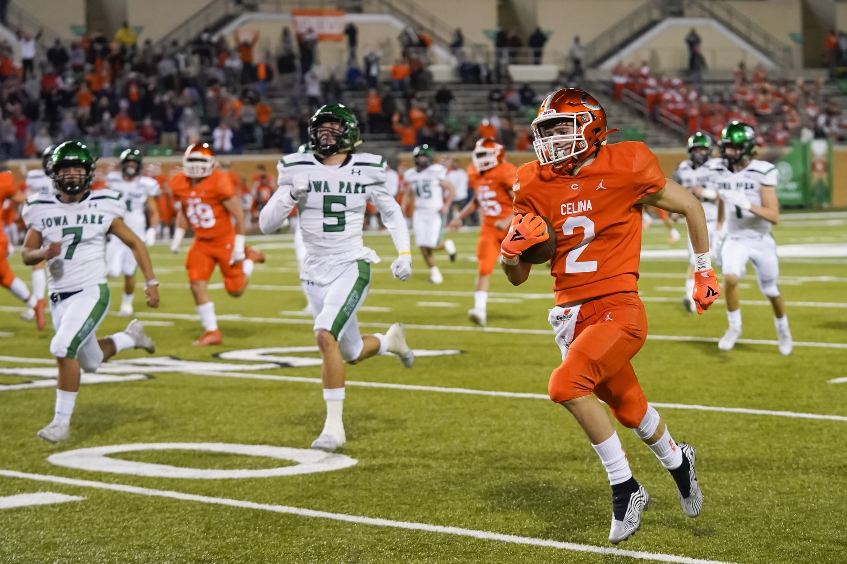 Celina wide receiver Collin Urich (2) returns the opening kickoff 91 yards for a touchdown past Iowa Park's Connor Anderson (5) during the first quarter of a Class 4A Division II Region I semifinal playoff high school football game at Apogee Stadium on Friday, Nov. 27, 2020, in Denton. (Smiley N. Pool/The Dallas Morning News)