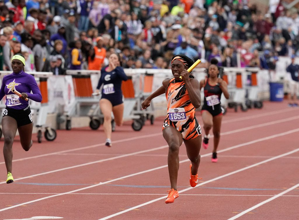Lancaster's Kiara Smith finishes the final leg of the Class 5A girls 4x100-meter relay at Friday's UIL State Championships at Texas' Mike A. Myers stadium.  The team finished in a time of 45.89 seconds to win the title. (Bob Daemmrich/Special Contributor)