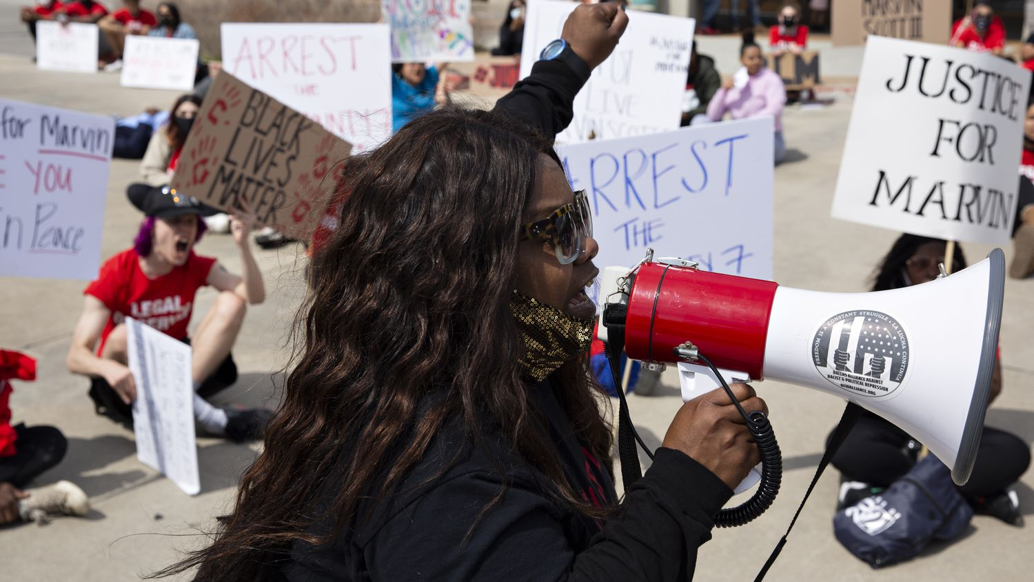 LaSandra Scott leads a chant in the Allen Outlets on Sunday, March 21, 2021 demanding justice for her son Marvin Scott III, who died a week prior while in custody at the Collin County Jail on March 14, 2021. Marvin Scott III was arrested at the Allen Outlets on a possession of marijuana charge. Demonstrators called for the arrest of the seven Collin County Jail employees who were placed on leave after Marvin's death.