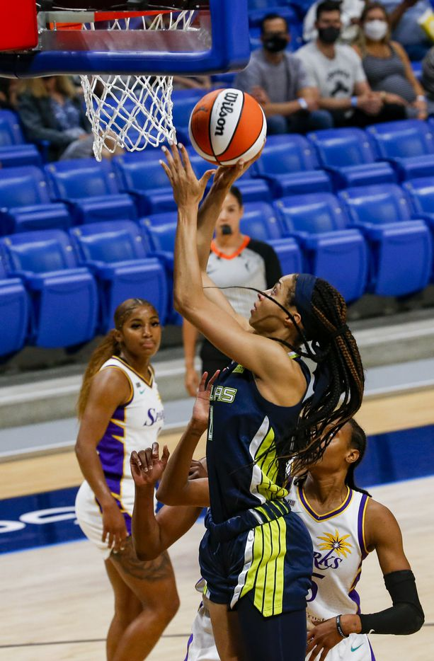 Dallas Wings forward Isabelle Harrison (20) goes for a lay up during the first quarter against the Los Angeles Sparks at College Park Center on Tuesday, June 1, 2021, in Arlington. (Juan Figueroa/The Dallas Morning News)