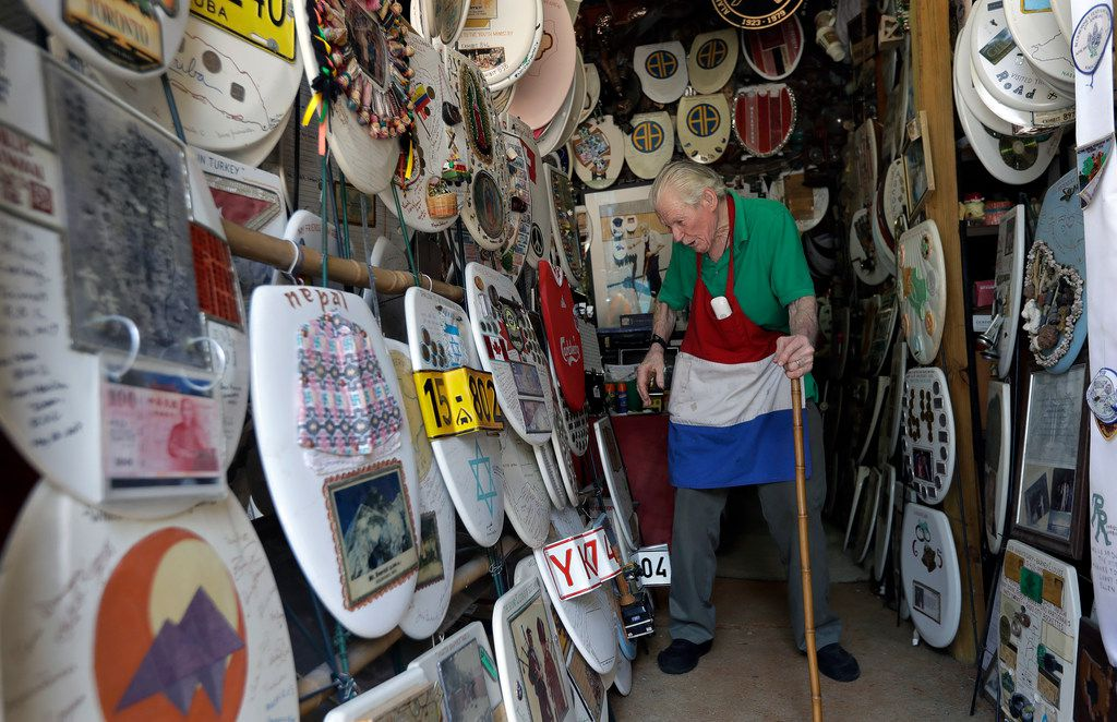 "Retired plumber Barney Smith, 97, walks through his Toilet Seat Art Museum in Alamo Heights. Smith, called ""King of the Commode,"" began his commode artwork in 1992."