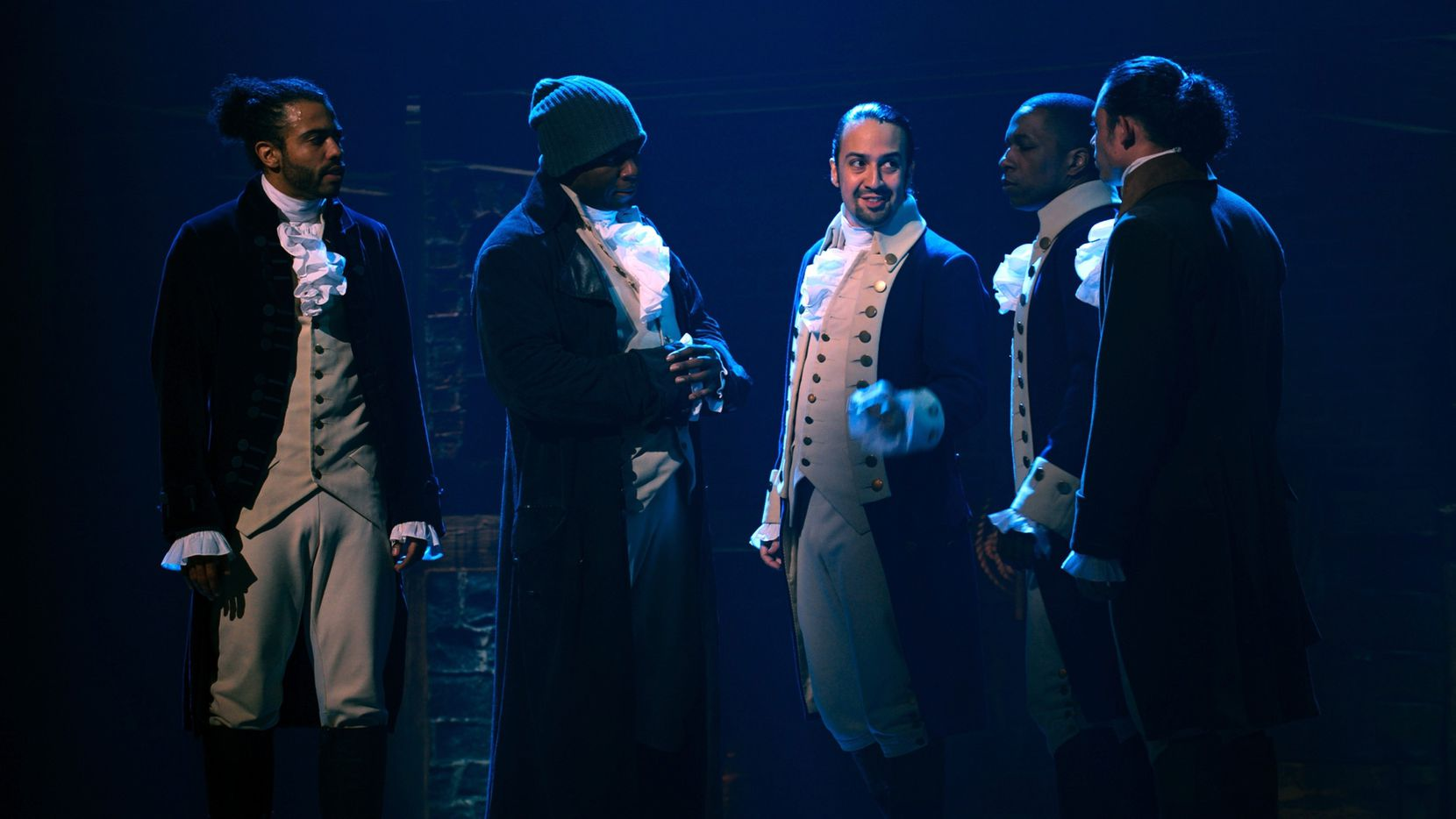 """Daveed Diggs (from left), Okieriete Onaodowan, Lin-Manuel Miranda, Leslie Odom Jr. and Anthony Ramos appear in the filmed version of the Broadway musical """"Hamilton,"""" which premieres on Disney+ on Friday."""