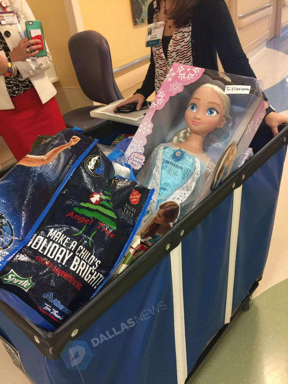 Rolling bin full of Christmas presents waiting to be delivered by Dirk Nowitzki at Children's Medical Center.