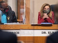 Commissioners John Wiley Price, left, and Elba Garcia, question a legal team as they conduct a presentation of the Dallas County Redistricting Plan during a Commissioners Court meeting, on Tuesday, Oct. 19, 2021 at the Allen Clemson Courtroom in downtown Dallas.