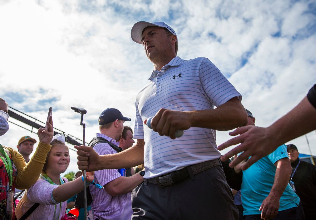Jordan Spieth high-fives fans as he makes his way to the first tee during round 3 of the Bryon Nelson golf tournament on Saturday, May 11, 2019 at Trinity Forest Golf Club in Dallas. (Ashley Landis/The Dallas Morning News)