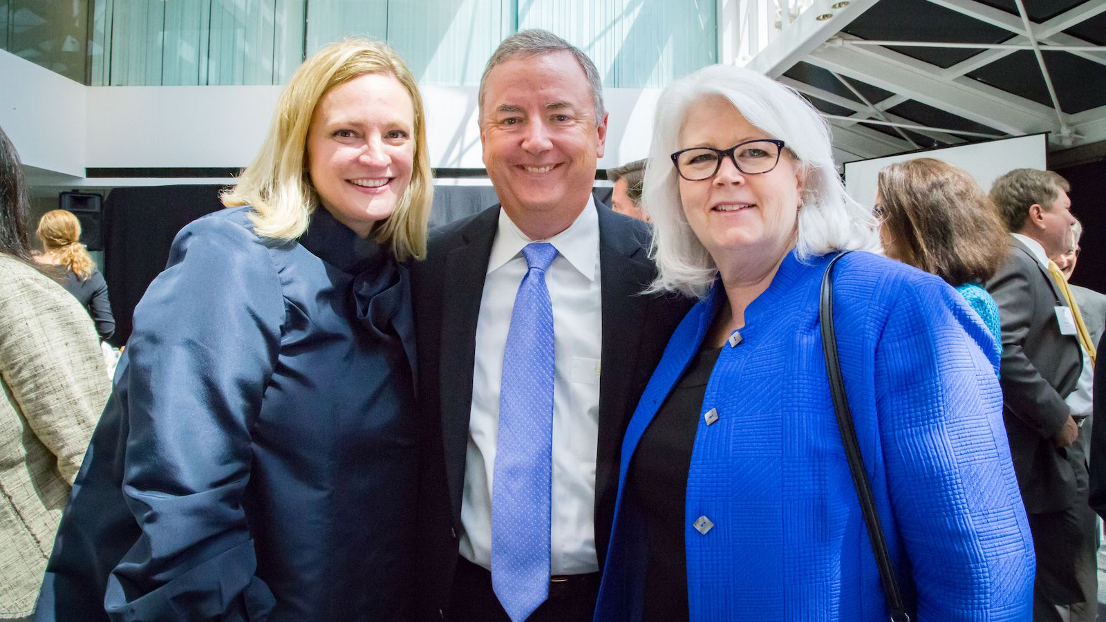 United Way of Metropolitan Dallas CEO and President Jennifer Sampson (left) stands with United Way Dallas 2019-20 campaign chairs Tom and Karen Falk at United Way's building-naming luncheon in January.