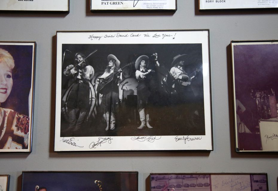 The original Dixie Chicks, pictured playing at the Lower Greenville location of the pub, are on the wall at Poor David's Pub in Dallas Feb. 15, 2017.