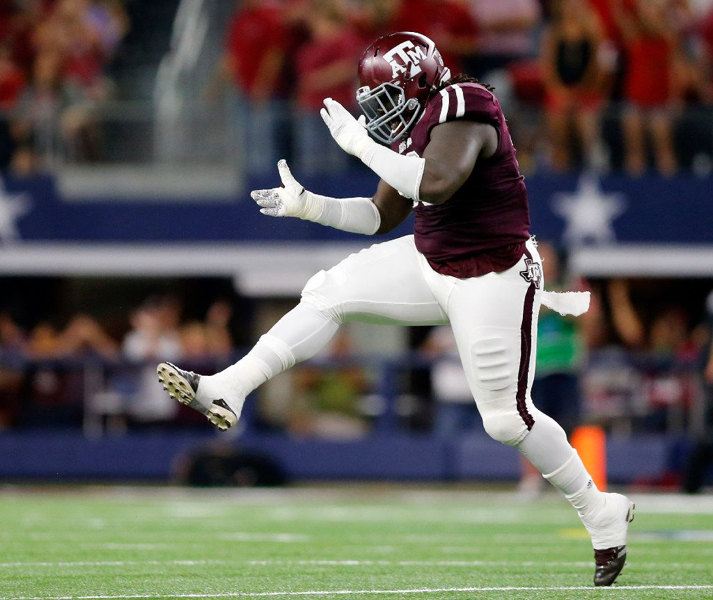 Texas A&M Aggies defensive lineman Reggie Chevis (13) celebrates a stop of the Arkansas Razorbacks in the first half of the Southwest Classic at AT&T Stadium in Arlington, Texas, Saturday, September 24, 2016. Texas A&M won, 45-24. (Tom Fox/The Dallas Morning News)