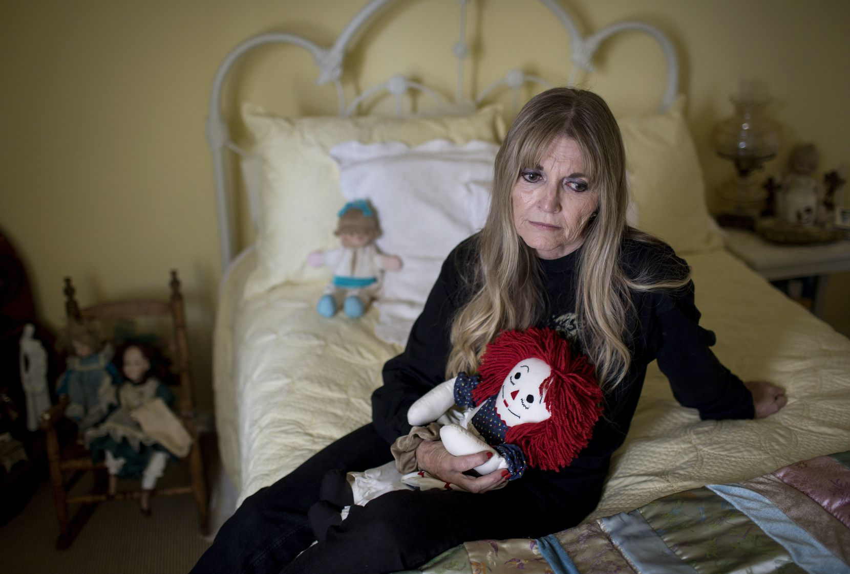"""Gwen Casados sits in her daughter's room in Houston. Her daughter, Heather Schneider, was sexually abused inside Second Baptist Church in Houston in 1994 and later died of a drug overdose. Heather Schneider was 14 when she was molested in a choir room at Houston's Second Baptist Church, according to criminal and civil court records. Her mother, Gwen Casados, said church leaders waited months to fire the attacker, who later pleaded no contest. In response to her lawsuit, church leaders also denied responsibility. Schneider slit her wrists the day after that attack in 1994, Casados said. She survived, but she died 14 years later from a drug overdose that her mother blames on the trauma. """"I never got her back,"""" Casados said."""